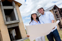 Couple holding blueprints Stock Photos