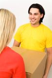 Couple holding box Stock Image
