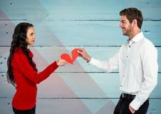 Couple holding a broken heart Stock Image