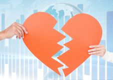 Couple holding a broken heart Stock Images