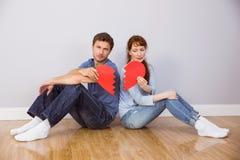 Couple holding a broken heart Royalty Free Stock Photos