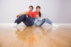 Couple holding a broken heart Stock Photography