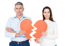 Couple holding broken heart Stock Photo