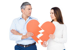 Couple holding broken heart Royalty Free Stock Images