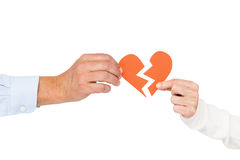 Couple holding broken heart Stock Photography