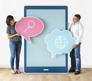 Couple holding browsing speech bubbles stock images