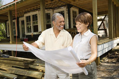 Couple Holding Building Plans Royalty Free Stock Image