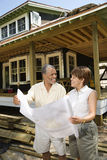 Couple Holding Building Plans Stock Photo