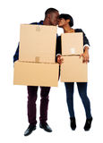 Couple holding cardboard boxes and kissing Stock Photos