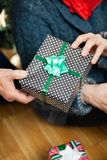 Couple Holding Christmas Present At Store Royalty Free Stock Photography