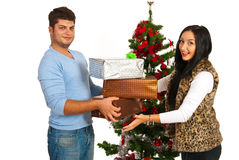 Couple holding Christmas presents Royalty Free Stock Photography