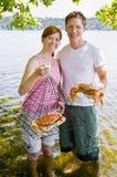 Couple holding crab Royalty Free Stock Photo