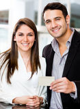 Couple holding a credit card Stock Photography