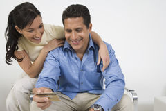Couple Holding Credit Card Royalty Free Stock Photo