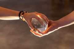 Couple holding a crystal ball together stock images