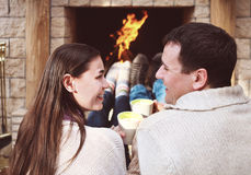 Couple holding cups with hot chocolate with marshmallows Stock Photos