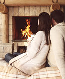 Couple holding cups with hot chocolate with marshmallows Royalty Free Stock Photography