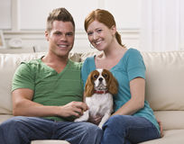 Couple Holding Dog stock photos
