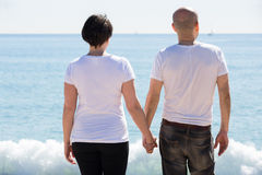 Couple holding each other on the beach royalty free stock photos