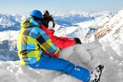 Couple holding each other in a sunny winter day Stock Photo