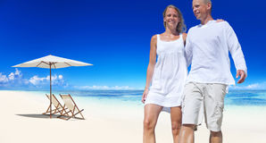 Couple Holding Each Other Walking By The Beach Royalty Free Stock Photos