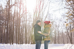 Couple holding each other's hands, the winter goes on the road, enjoying a stroll, a love couple. Husband and wife are Stock Photos