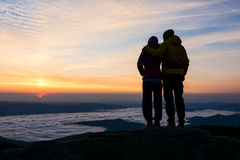 Couple holding eachother in the sunrise royalty free stock photo