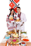 Couple are holding Easter cakes Royalty Free Stock Photos