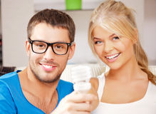 Couple holding energy saving bulb Royalty Free Stock Photos