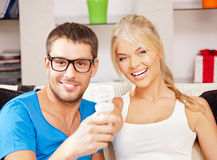 Couple holding energy saving bulb Stock Image