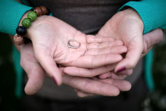 Couple holding engagement ring Stock Photo
