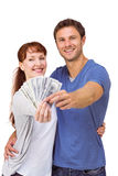 Couple holding fan of cash Royalty Free Stock Photos