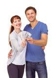 Couple holding fan of cash Stock Photo
