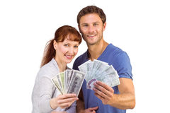 Couple holding fans of cash Royalty Free Stock Photos