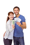 Couple holding fans of cash Stock Photography