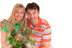 Couple holding flowers Stock Images