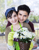Couple holding flowers Royalty Free Stock Images