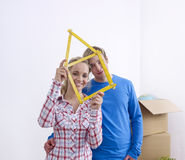 Couple holding folding rule Stock Photos