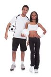 Couple Holding Football In Hand Royalty Free Stock Photography