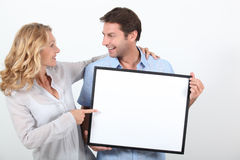Couple holding a frame Stock Image