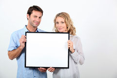 Couple holding frame Stock Photos
