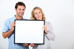 Couple holding frame Stock Photography
