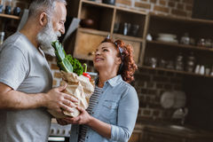 Couple holding fresh vegetables royalty free stock images