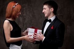 Couple holding gift box together Royalty Free Stock Photos