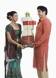 Couple holding gifts on Diwali Stock Photos