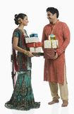Couple holding gifts on Diwali Royalty Free Stock Photo