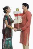 Couple holding gifts on Diwali Royalty Free Stock Images