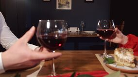 Cropped view of male and female hands holding wine