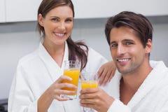 Couple holding glass of orange juice Royalty Free Stock Photo