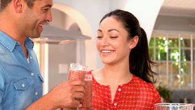 Couple holding glass of smoothie
